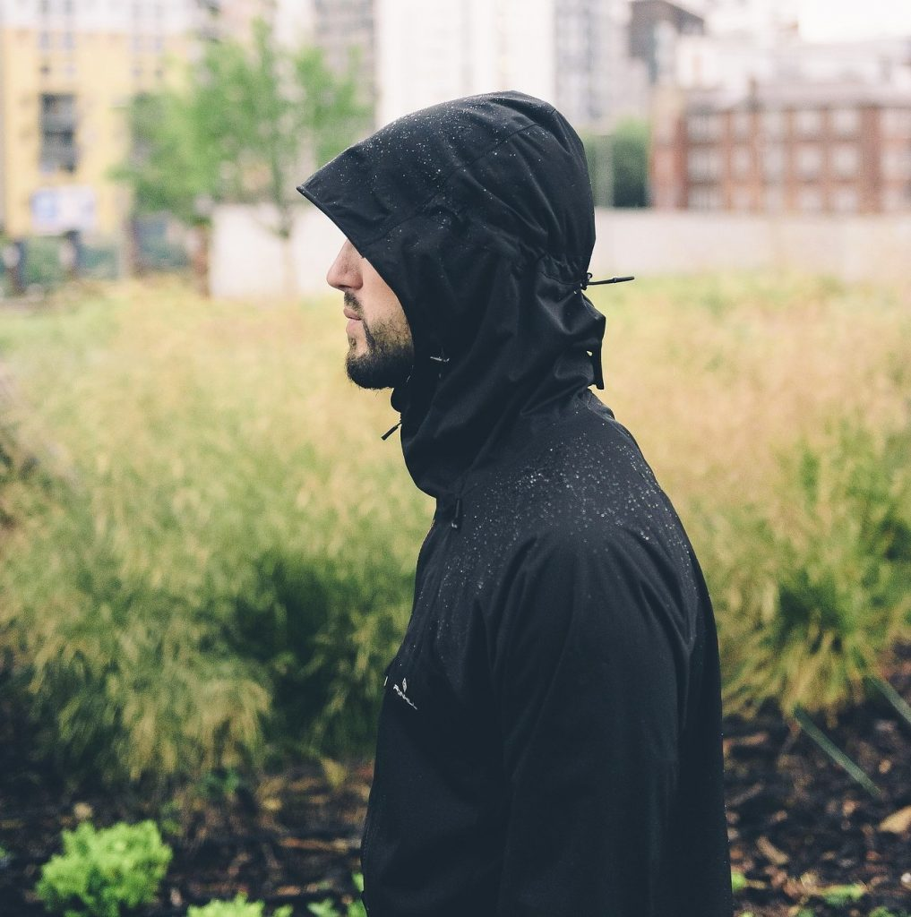 Men wearing a light rain jacket.
