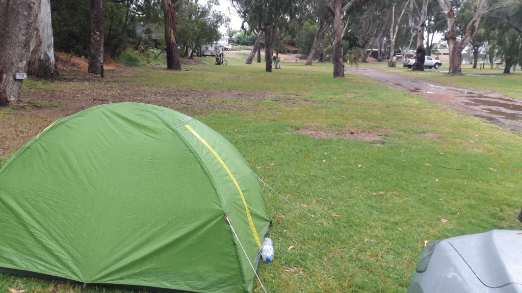 Green tent in Western Australia on a rainy day.